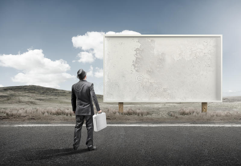 Businessman and Old Blank Billboard stock images