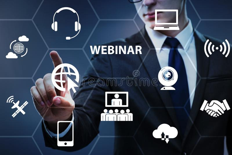 The businessman in online webinar concept stock photography