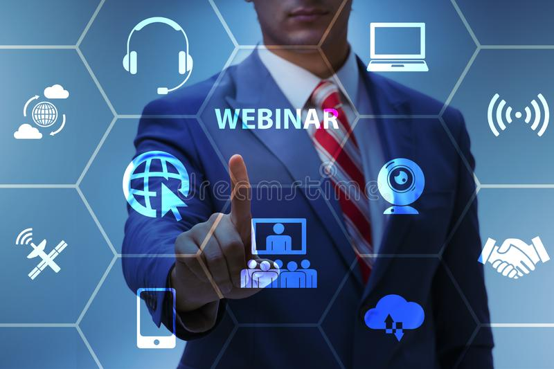 The businessman in online webinar concept royalty free stock photo