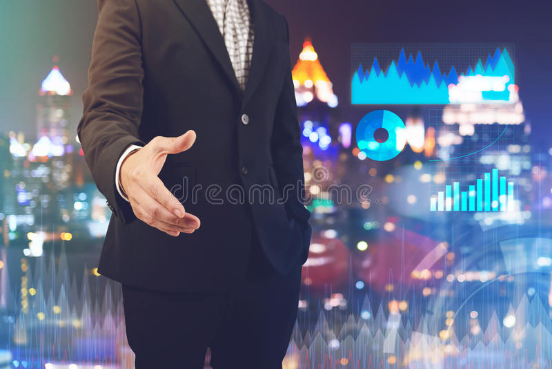Businessman open hand for handshake to make a deal with business diagram royalty free stock photos