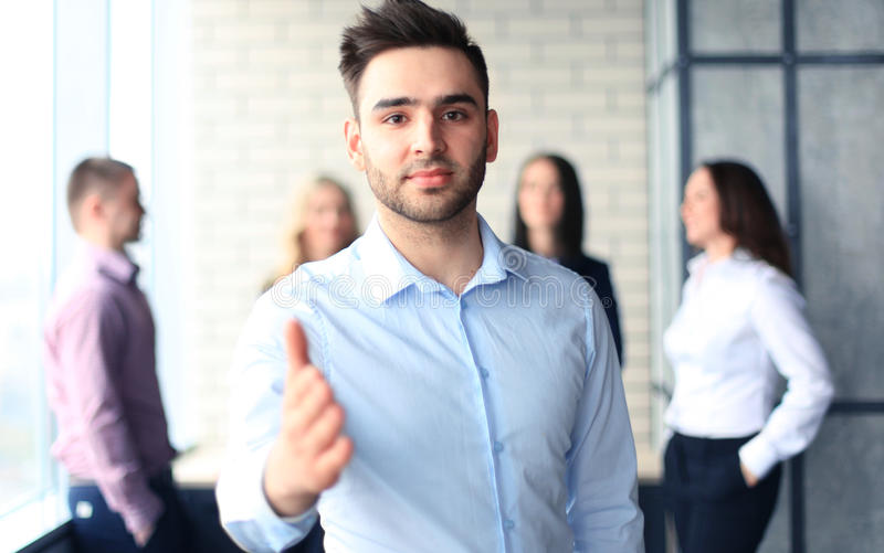 Businessman. With an open hand ready to seal a deal royalty free stock images