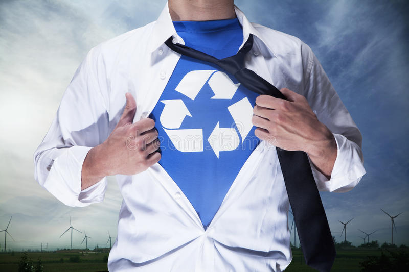Businessman with open short revealing shirt with recycling symbol underneath royalty free stock photos