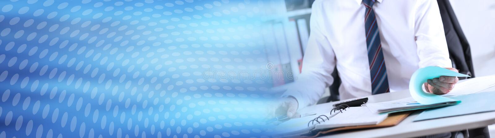 Businessman opening a folder. panoramic banner. Businessman opening a folder on his desk. panoramic banner stock photo
