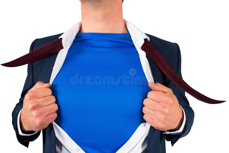 Businessman opening his shirt superhero style royalty free stock images