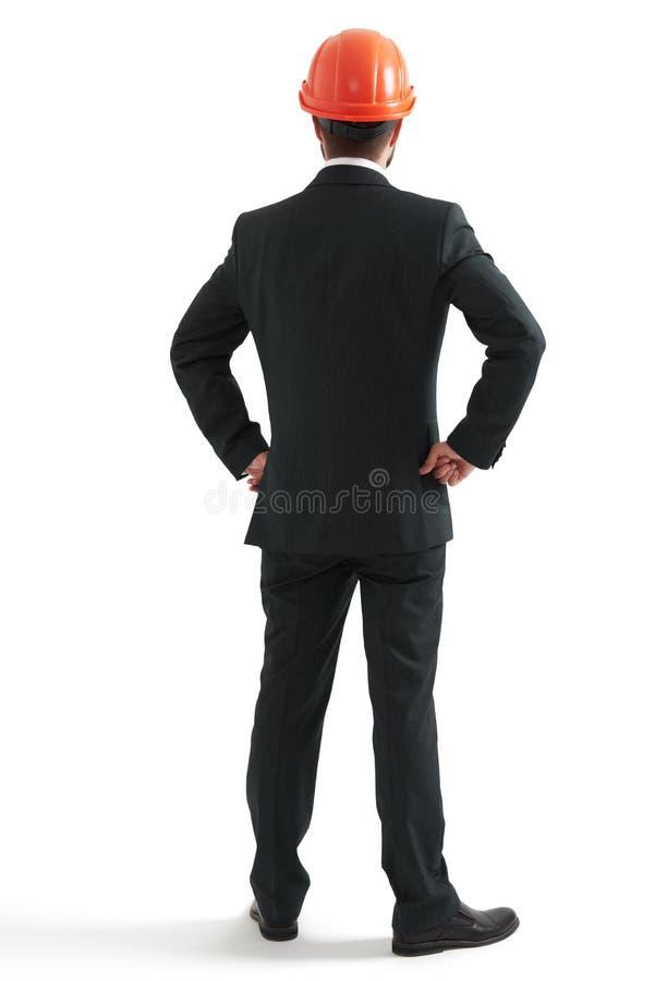 Businessman in orange hardhat royalty free stock photo