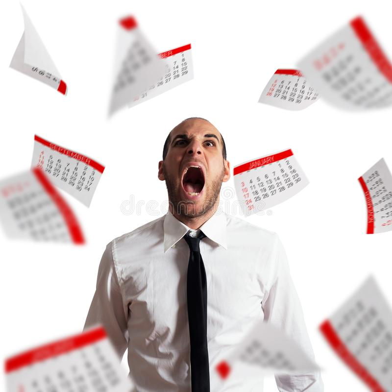 Businessman stressed and overworked screaming in office with flying paper sheets royalty free stock image