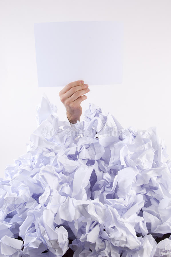 Businessman overwhelmed by paper stock photo