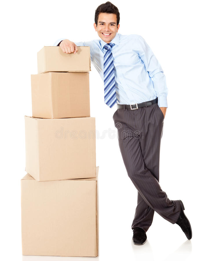 Businessman packing in carton boxes
