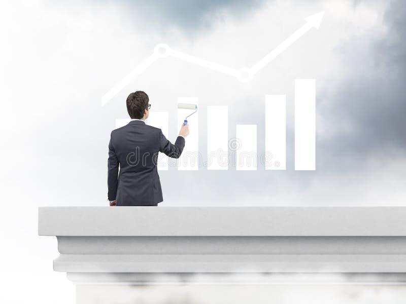 Businessman painting bar chart royalty free stock image