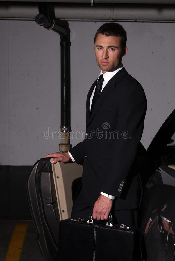 Businessman in parking lot stock photos