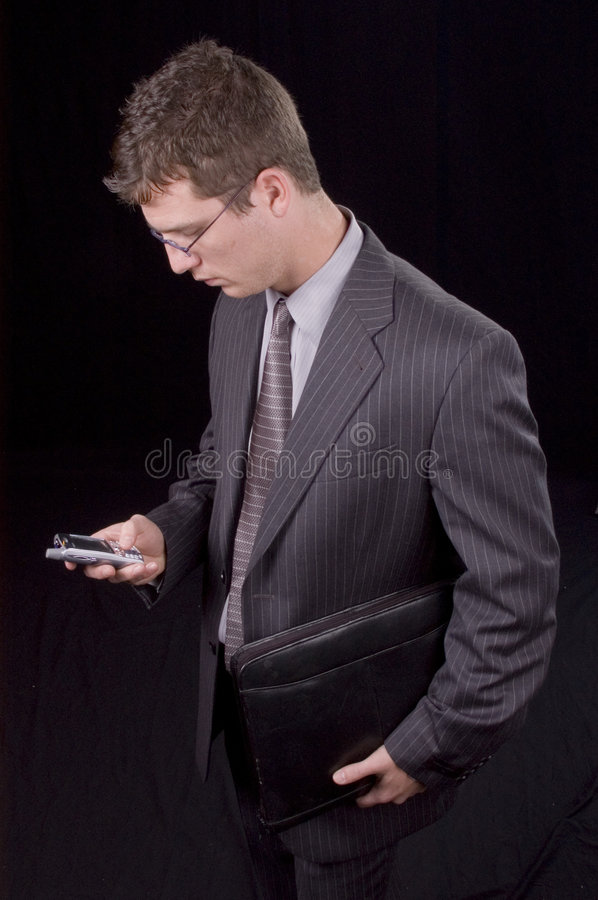 Businessman and PDA royalty free stock image