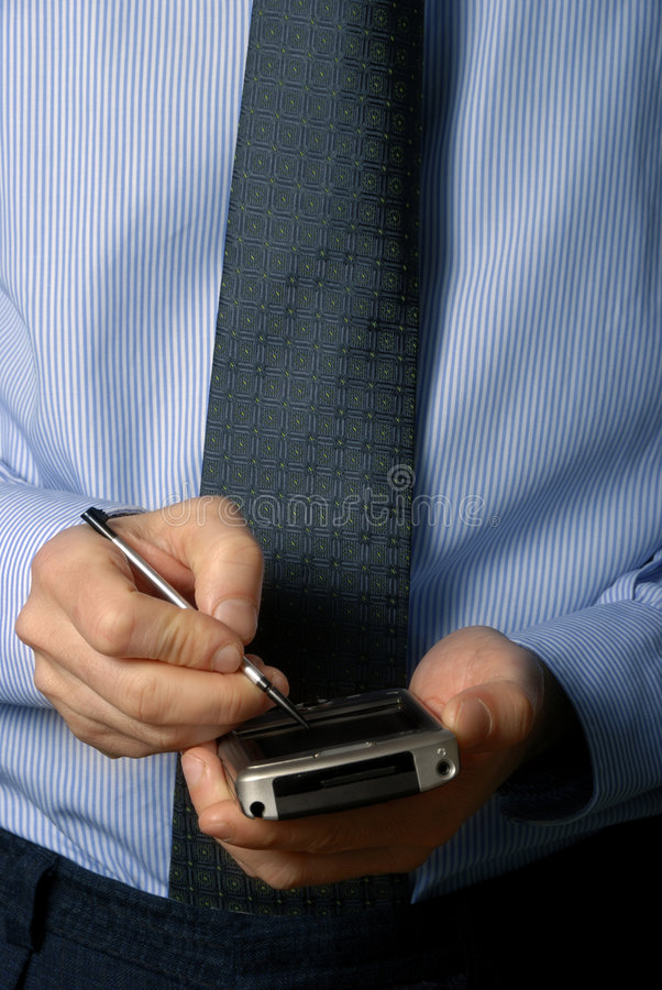 Businessman with pda stock photography