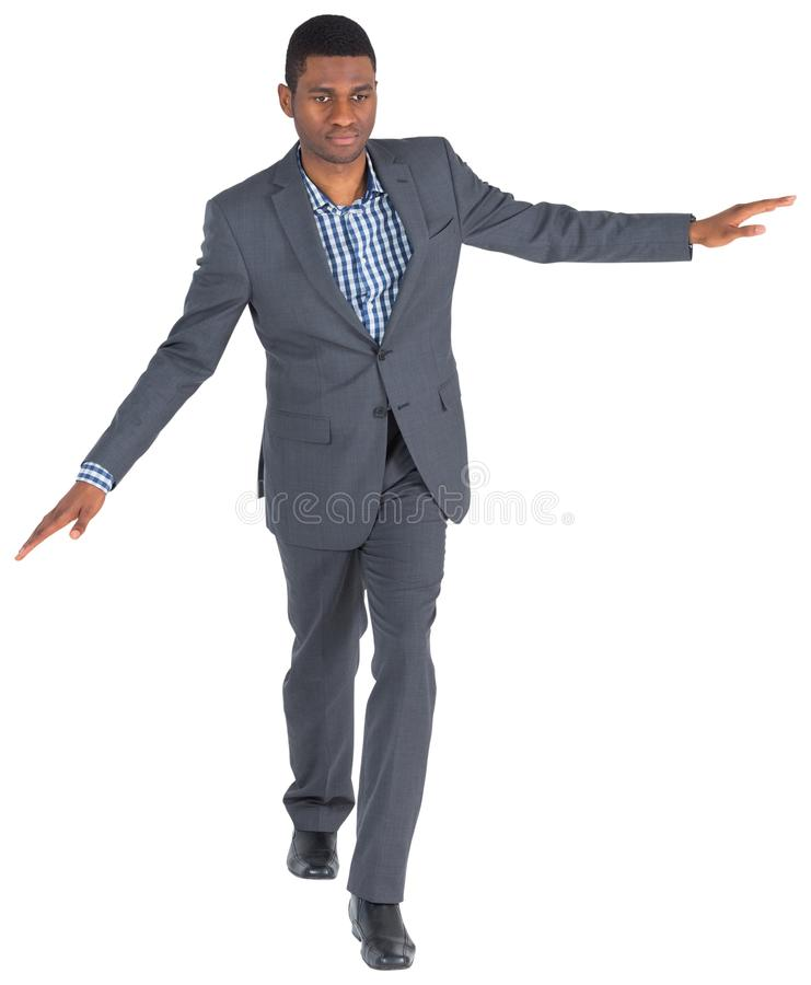 Businessman performing a balancing act stock images