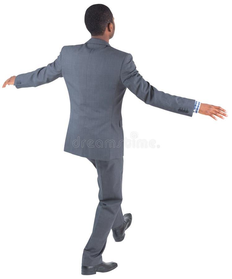Businessman performing a balancing act stock photos