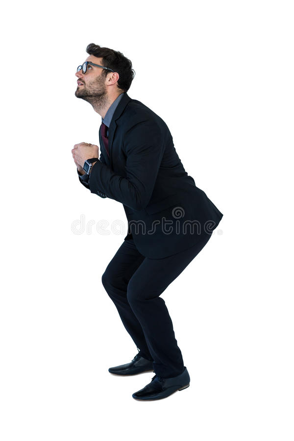 Businessman performing exercise royalty free stock image