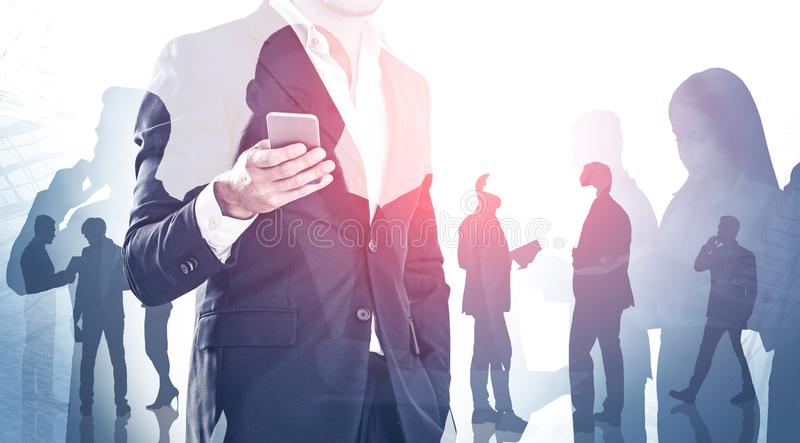 Businessman with phone and his team stock images