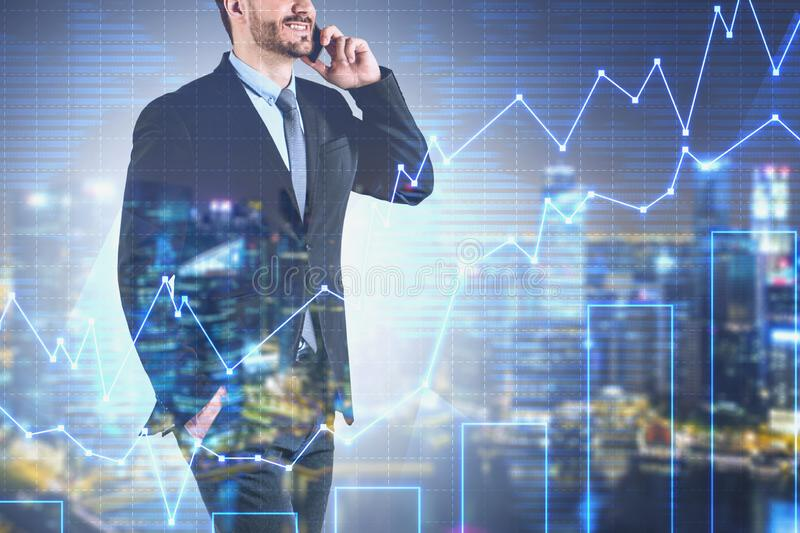 Businessman on phone in night city, graph stock photo