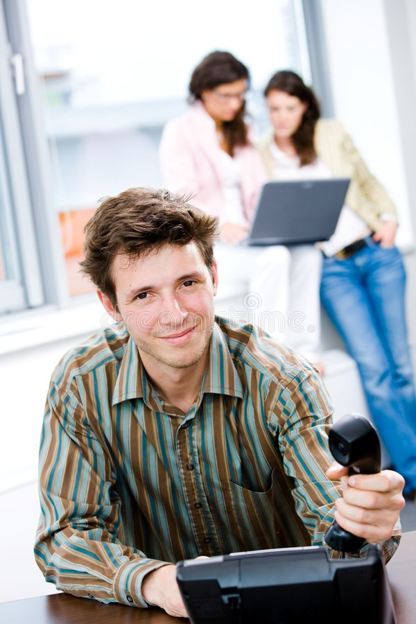 Businessman with phone at office stock photo