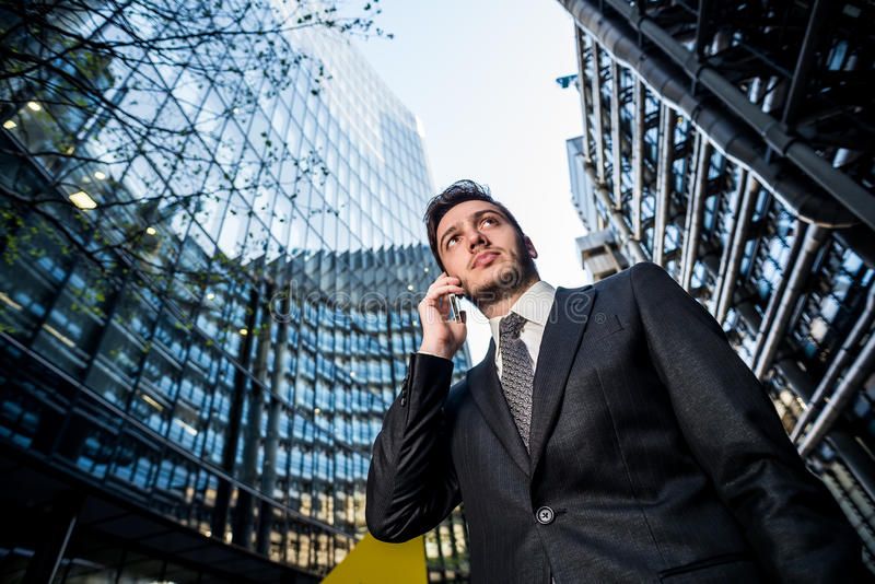 Businessman on phone office building stock image