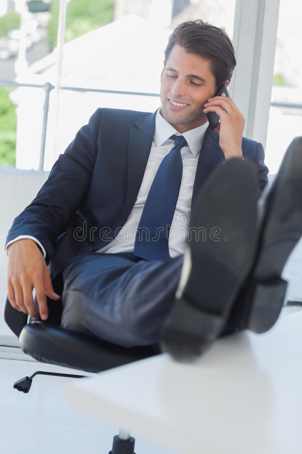 Download Businessman On The Phone Relaxing With His Feet On His Desk Stock Image - Image: 32804239