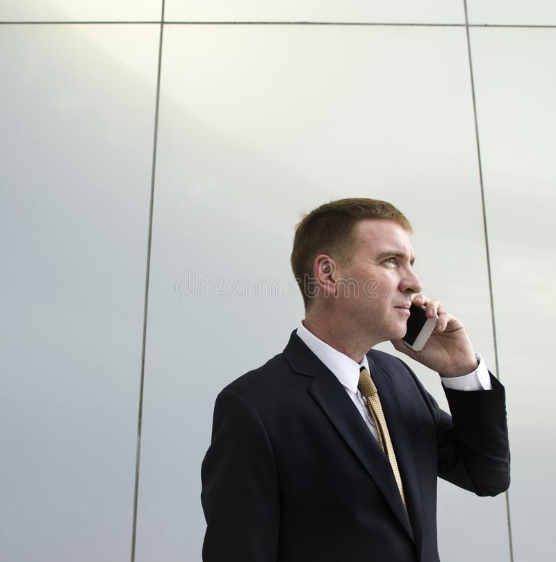 Businessman on the phone talking with someone stock photos