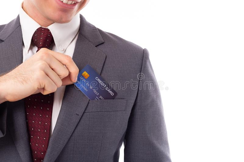 Businessman pick credit card from suit pocket for paying, buying, shopping product with smiley face, happiness. Handsome young royalty free stock photo