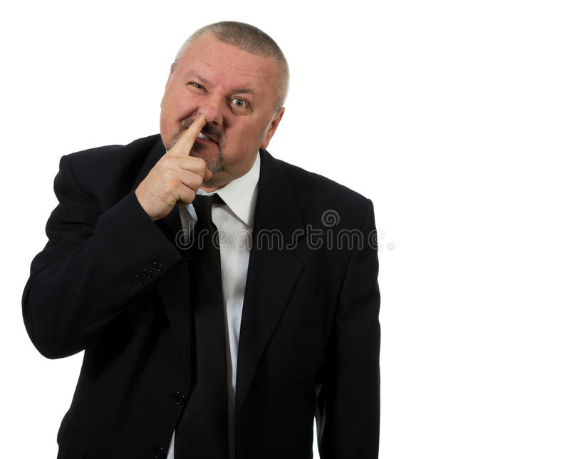 Businessman picks nose royalty free stock photo