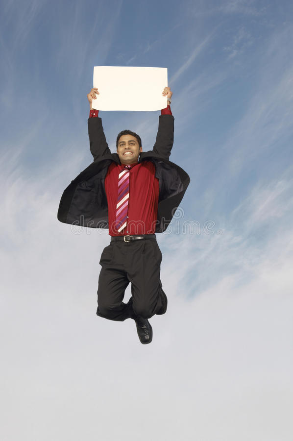 Download Businessman With A Placard In Midair Stock Photo - Image of empty, middle: 29649222