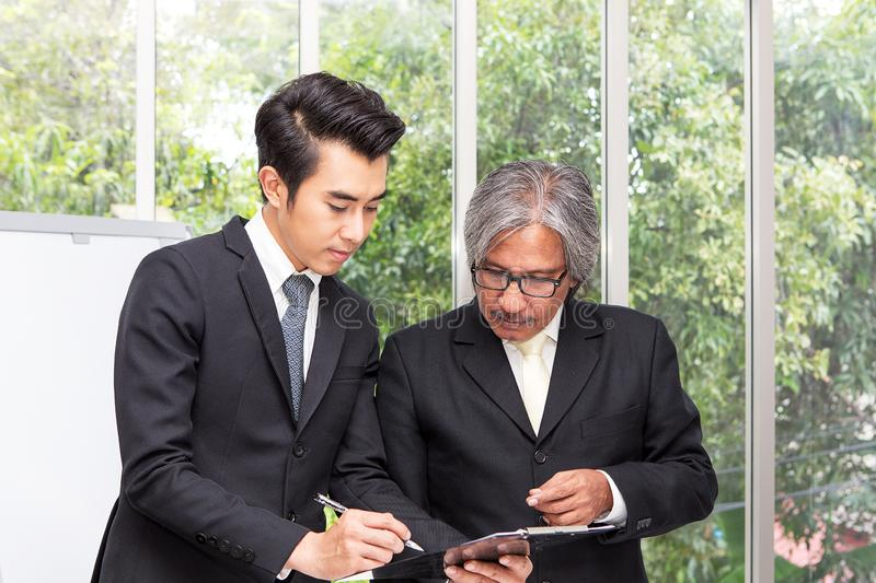 Businessman plaining data at meeting. Business people meeting ar. Ound desk. asian people royalty free stock photos