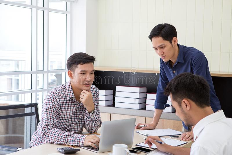Businessman plaining data at meeting. Business people meeting ar. Ound desk. Asian people. Young business man. Business people working together royalty free stock images