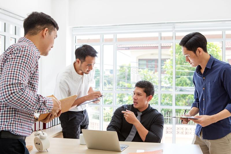 Businessman plaining data at meeting. Business people meeting ar. Ound desk. Asian people. Young business man. Business people working together royalty free stock photography