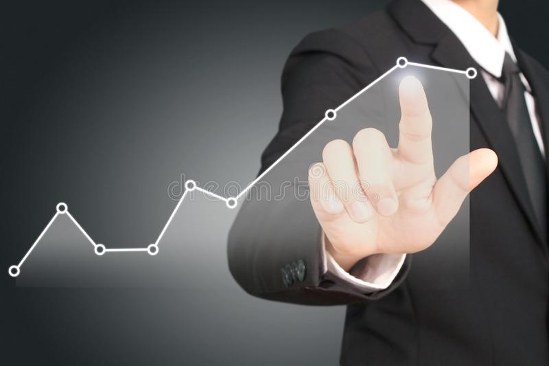 Businessman plan graph growth and increase of chart positive ind. Icators in his business stock photography