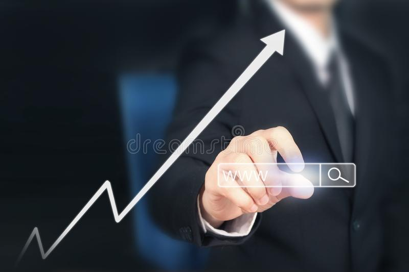 Businessman plan graph growth and increase of chart positive ind. Icators in his business royalty free stock image