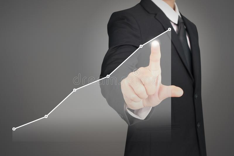Businessman plan graph growth and increase of chart positive ind. Icators in his business stock photo