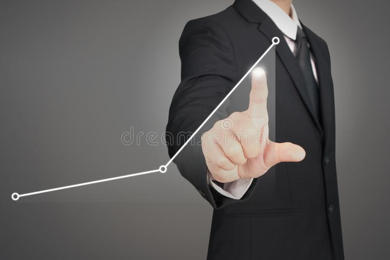 Businessman plan graph growth and increase of chart positive ind. Icators in his business stock photos