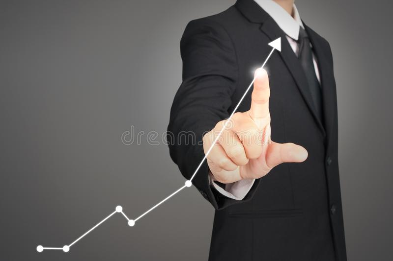 Businessman plan graph growth and increase of chart positive ind. Icators in his business royalty free stock images