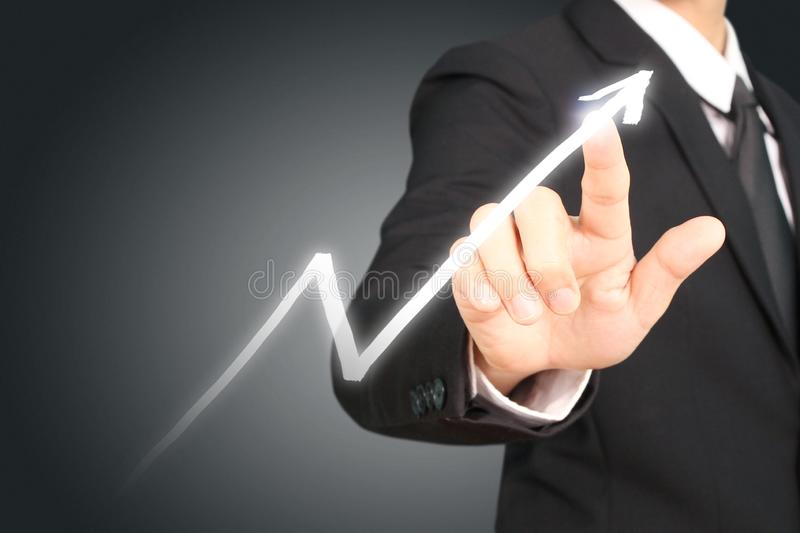 Businessman plan graph growth and increase of chart positive ind. Icators in his business stock images