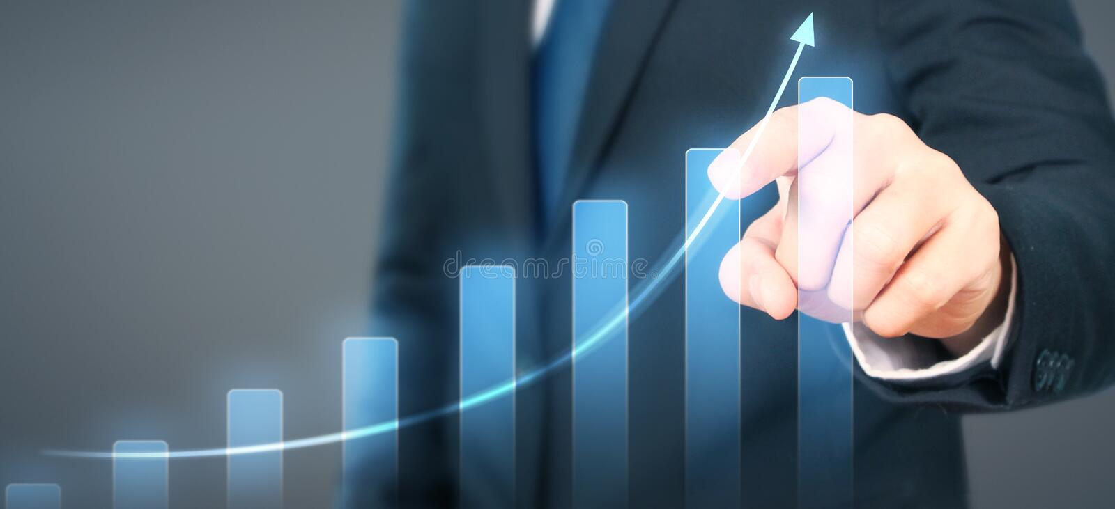 Businessman plan graph growth increase of chart positive indicators in his business. Businessman plan graph growth and increase of chart positive indicators in royalty free stock photo