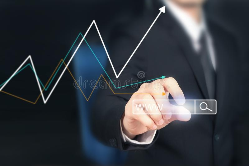 Businessman plan graph growth and increase of chart positive ind. Icators in his business stock image