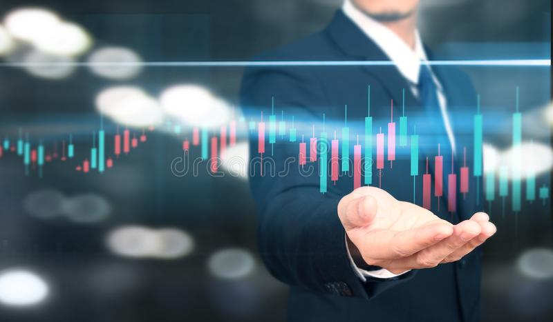 Businessman plan graph growth and increase of chart positive indicators i. N his business royalty free stock image