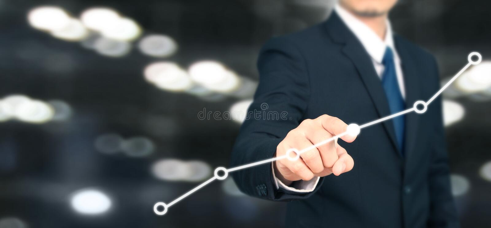 Businessman plan graph growth and increase of chart positive indicators i. N his business stock photography