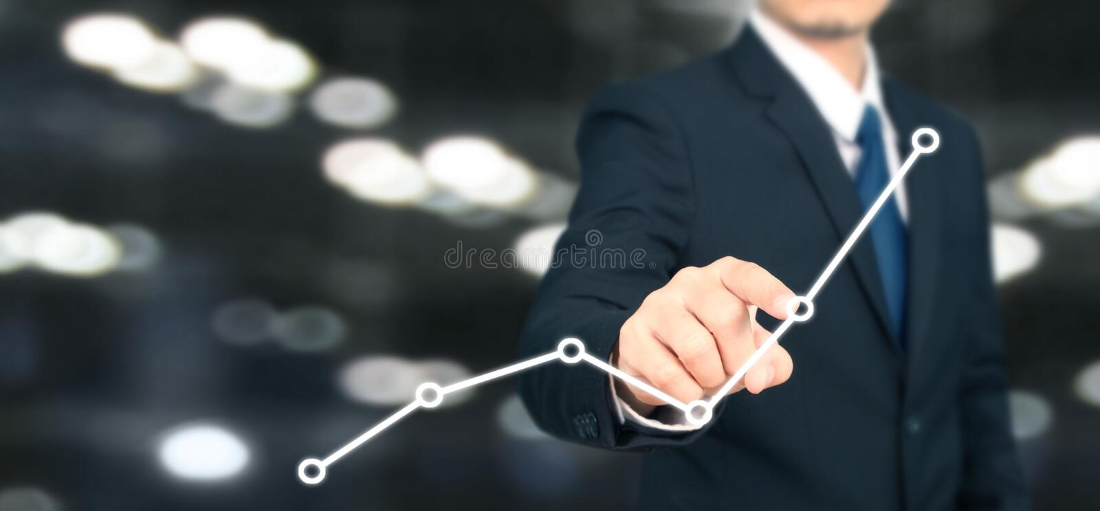 Businessman plan graph growth and increase of chart positive indicators i. N his business royalty free stock photography