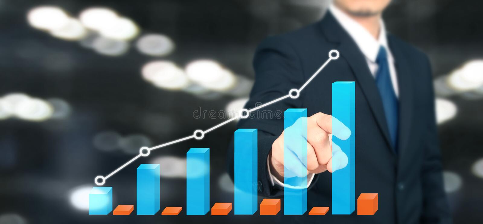 Businessman plan graph growth and increase of chart positive indicators i. N his business stock photo