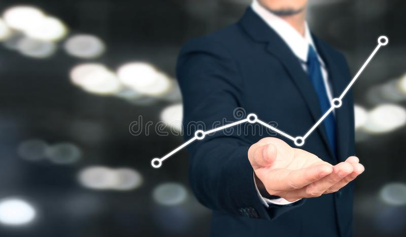 Businessman plan graph growth and increase of chart positive indicators i. N his business stock images