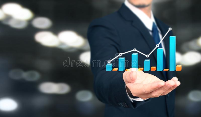 Businessman plan graph growth and increase of chart positive indicators i. N his business royalty free stock images