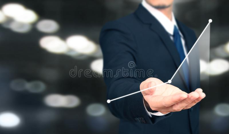 Businessman plan graph growth and increase of chart positive indicators i. N his business royalty free stock photos