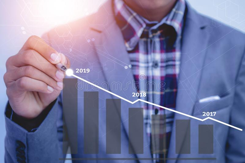 Businessman plan growth in 2019 year and increase of positive in. Dicators in his business royalty free stock image