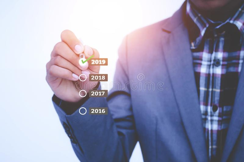 Businessman plan growth in 2019 year and increase of positive in. Dicators in his business stock photo