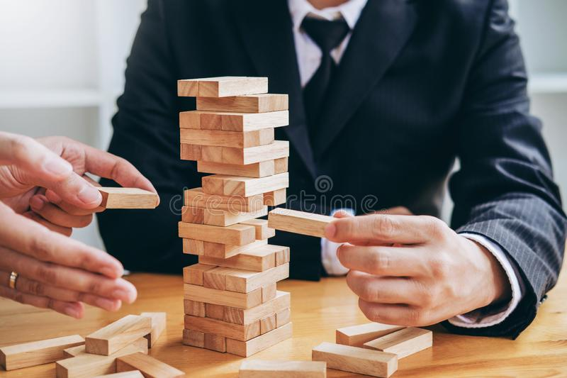 Businessman plan and strategy in business Domino Effect Problem Solving royalty free stock images