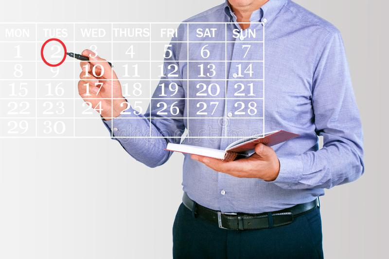 Businessman planning business schedule with notepad. stock photography